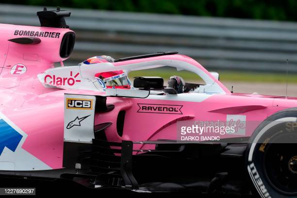 Racing Point's Mexican driver Sergio Perez steers his car during the Formula One Hungarian Grand Prix race at the Hungaroring circuit in Mogyorod...