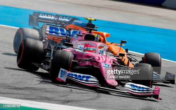 Racing Point's Mexican driver Sergio Perez steers his car in front of McLaren's British driver Lando Norris during the Formula One Styrian Grand Prix...