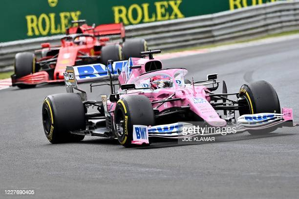 Racing Point's Mexican driver Sergio Perez steers his car in front of Ferrari's German driver Sebastian Vettel driver Charles Leclerc during the...