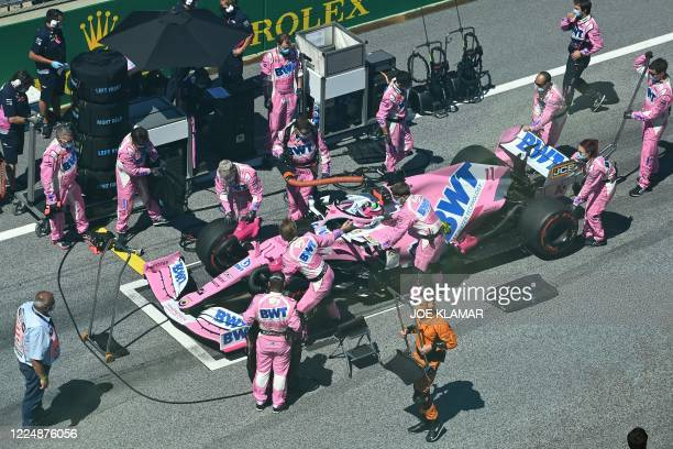 Racing Point's Mexican driver Sergio Perez's car is prepared prior to the Austrian Formula One Grand Prix race on July 5, 2020 in Spielberg, Austria.