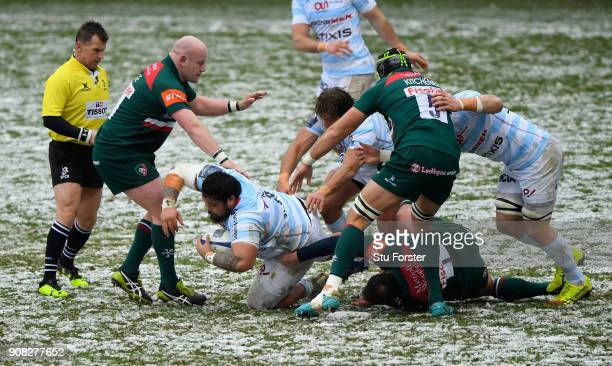 Racing prop Ben Tameifuna makes yardage in the snow during the European Rugby Champions Cup match between Leicester Tigers and Racing 92 at Welford...