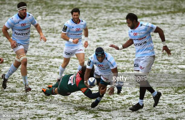 Racing prop Eddy Ben Arous breaks the tackle of Tigers hooker Tatafu PolotaNau during the European Rugby Champions Cup match between Leicester Tigers...