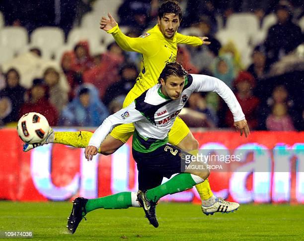 Racing Santander's Brazilian defender Henrique vies with Villarreal's midfielder Cani during the Spanish league football match Racing vs Villarreal...