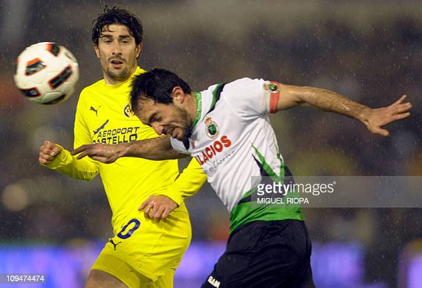 Racing Santander's forward Pedro Munitis vies with Villarreal's Villarreal's midfielder Cani during the Spanish league football match Racing vs...