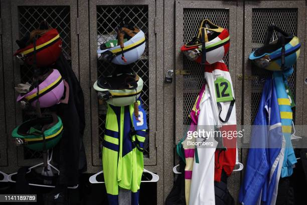 Racing silks and helmets hang from lockers in the jockeys locker room before the 145th running of The Kentucky Derby at Churchill Downs in Louisville...