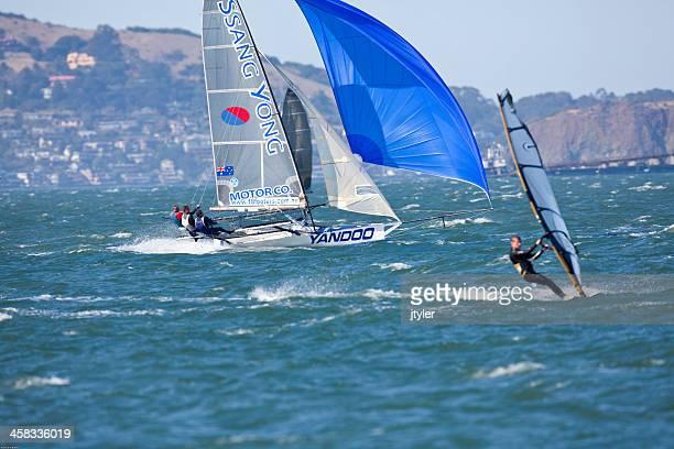 Racing Skiff and Windsurfer