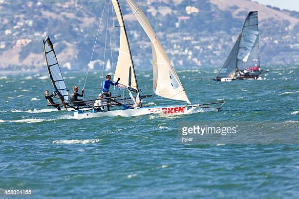 racing skiffs and windsurfer - sail boom stock pictures, royalty-free photos & images