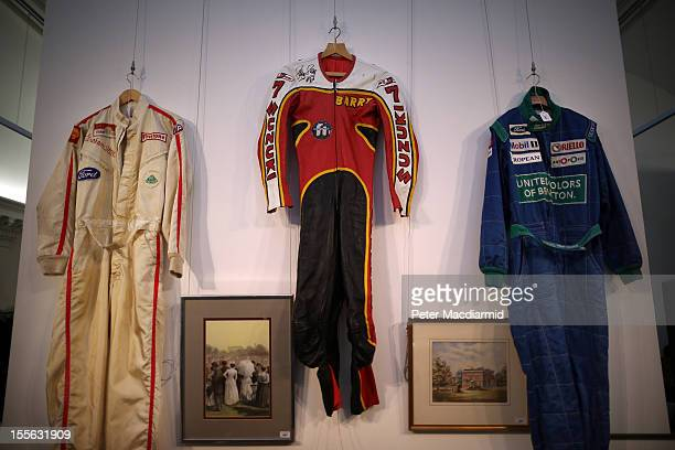 Racing suits worn by Graham Hill Barry Sheene and Nelson Piquet are displayed at Sotheby's on November 6 2012 in London England Graham Budd...