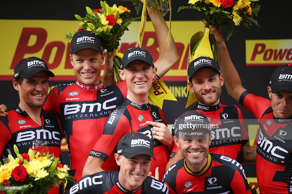 Racing Team celebrate their victory on the podium following stage nine of the 2015 Tour de France, a 28km team time trial between Vannes and Plumelec on July 12, 2015 in Vannes, France.