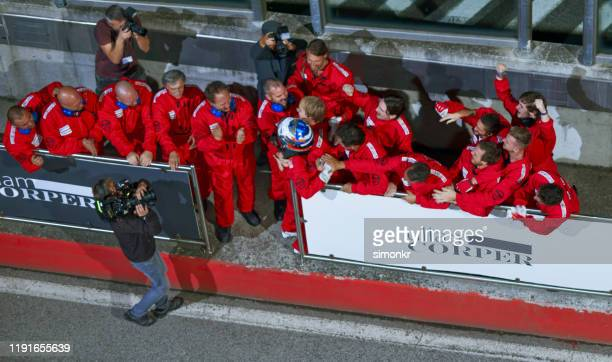 racing team celebrating victory - motorsport stock pictures, royalty-free photos & images