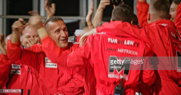 racing team celebrating victory - sports team stock pictures, royalty-free photos & images