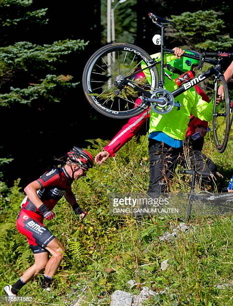 BMC Racing Team rider Germany's Dominik Nerz seen after a crash during the second stage of the Arctic Race of Norway on August 9 2013 in Svolvaer...
