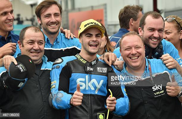 SKY Racing Team VR46 rider Romano Fenati of Italy celebrates taking pole position with his team mechanics after the Moto3 class qualifying session of...