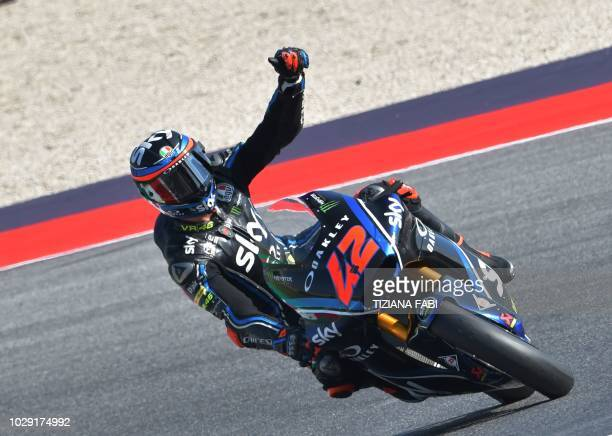 Racing Team VR46's Italian rider Francesco Bagnaia celebrates winning the pole position after the qualifying session of the San Marino Moto2 Grand...
