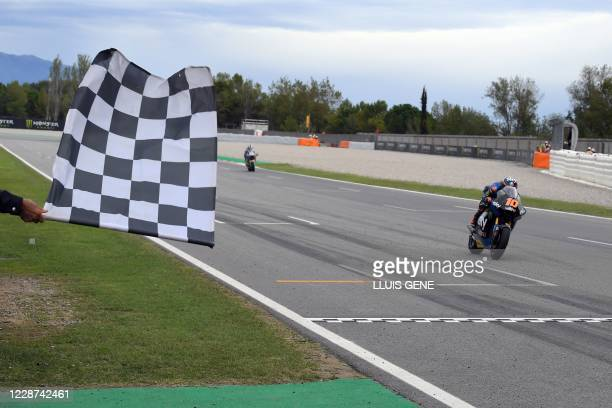 Racing Team VR46's Italian rider Luca Marini crosses the finish line winning the Moto2 race of the Moto Grand Prix de Catalunya at the Circuit de...