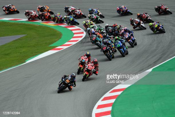 Racing Team VR46's Italian rider Luca Marini leads the race after the start of the Moto2 race of the Moto Grand Prix de Catalunya at the Circuit de...