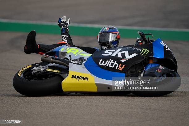 Racing Team VR46's Italian rider Marco Bezzecchi reacts after crashing while competing in the Moto2 race at the Grand Prix of Teruel at the Motorland...