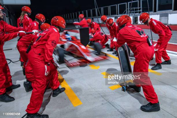 racing team working at pit stop - pit stop stock pictures, royalty-free photos & images