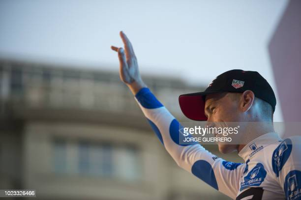 """Racing Team's Australian cyclist Rohan Dennis waves on the podium after winning the first stage of the 73rd edition of """"La Vuelta"""" Tour of Spain..."""