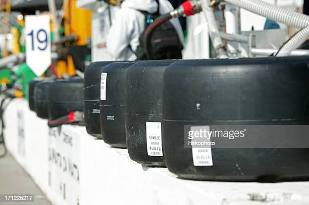 racing tires on pit wall - nascar stock pictures, royalty-free photos & images