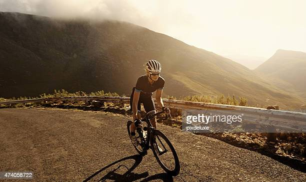 racing towards her fitness goal - cycling stock pictures, royalty-free photos & images