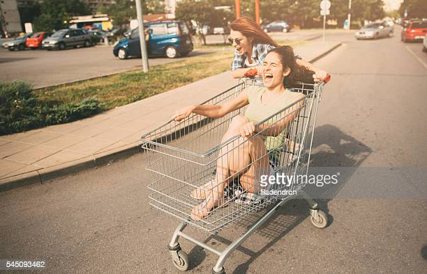 racing with a shopping cart - opstand stockfoto's en -beelden