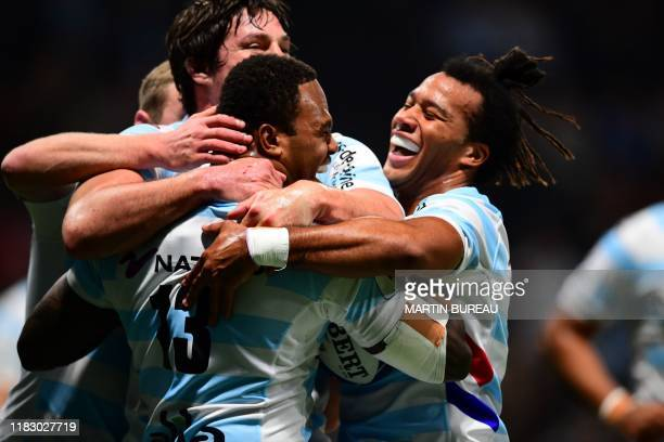 Racing92's Fijian centre Virimi Vakatawa is congratulated by his teammates after scores a try during the European Champions Cup rugby union match...