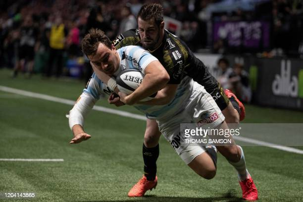 Racing92's French centre Olivier Klemenczak is tackled by La Rochelle's French wing Arthur Retiere as he scores a try during the French Top 14 rugby...