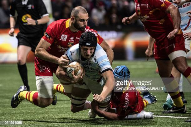 Racing92's French flanker Baptiste Chouzenoux dives with the ball during the French Top 14 Rugby Union match between Racing 92 and Perpignan at the U...