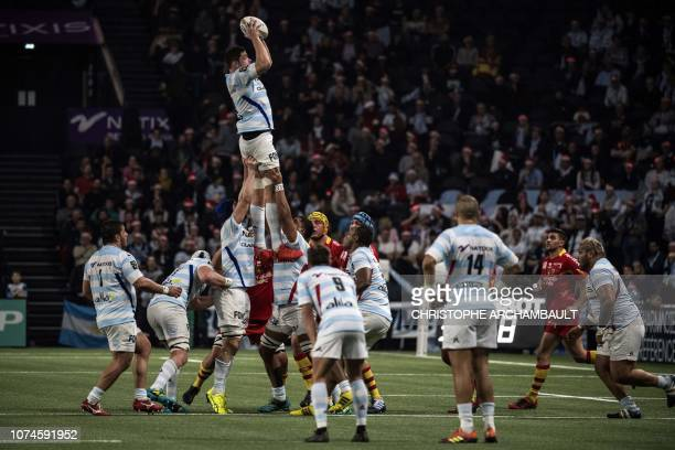 Racing92's French flanker Fabien Sanconnie catches the ball during the French Top 14 Rugby Union match between Racing 92 and Perpignan at the U Arena...