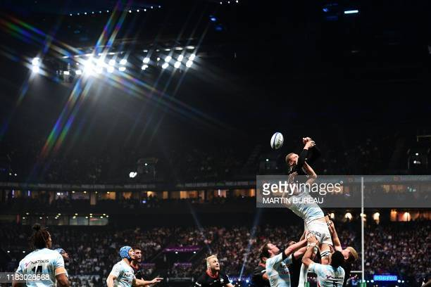 Racing92's French flanker Wenceslas Lauret fights for ther ball with Saracens' English flanker Nick Isiekwe during the European Champions Cup rugby...