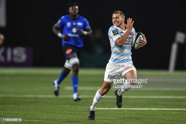 Racing92's French flyhalf Antoine Gibert runs to score a try during the French Top 14 rugby union match between Racing 92 and Castres on September 1...