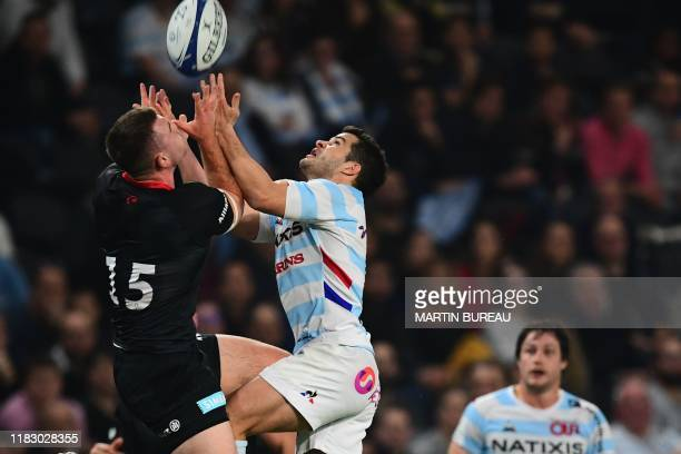 Racing92's French full back Brice Dulin fights for the ball with Saracen's English full back Matt Gallagher during the European Champions Cup rugby...