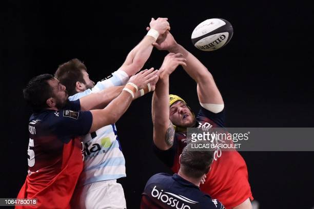Racing92's French full back Louis Dupichot vies withe Grenoble's French lock Mickael Capelli during the French Top 14 rugby union match between...