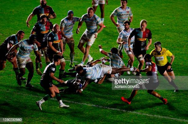 Racing92's French prop Georges-Henri Colombe Reazel scores a try during the European Rugby Champions Cup first round, Pool B, rugby union match...