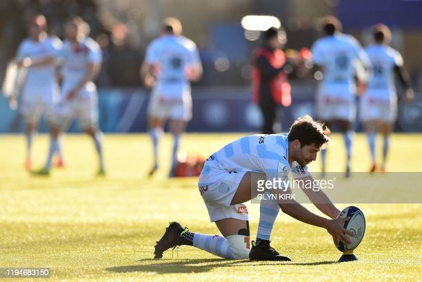 Racing92's French scrumhalf Teddy Iribaren prepaers to ball for his conversion kick after the team's second try during the European Champions Cup...