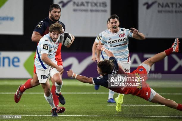 TOPSHOT Racing92's French scrumhalf Teddy Iribaren runs with the ball during the French Top 14 rugby union match between Racing 92 and Grenoble at...