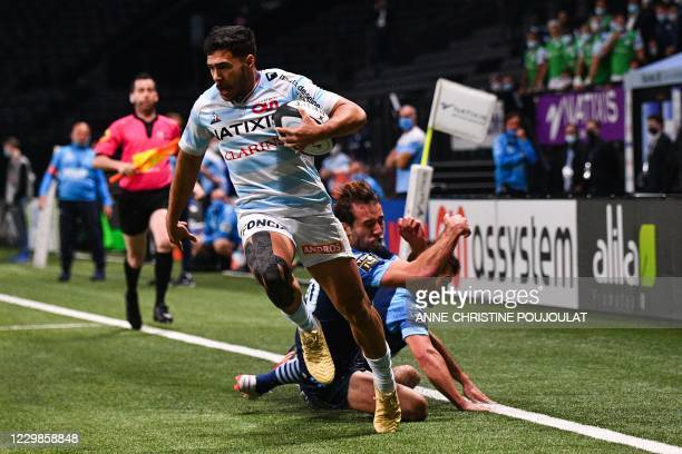 Racing92's French wing Donovan Taofifenua scores a try during the French Top 14 rugby union match between Racing 92 and Aviron Bayonnais at the Paris...