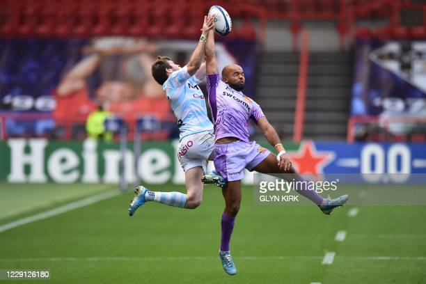 Racing92's French wing Louis Dupichot competes for a high ball with Exeter Chiefs' English wing Tom O'Flaherty during the European Rugby Champions...