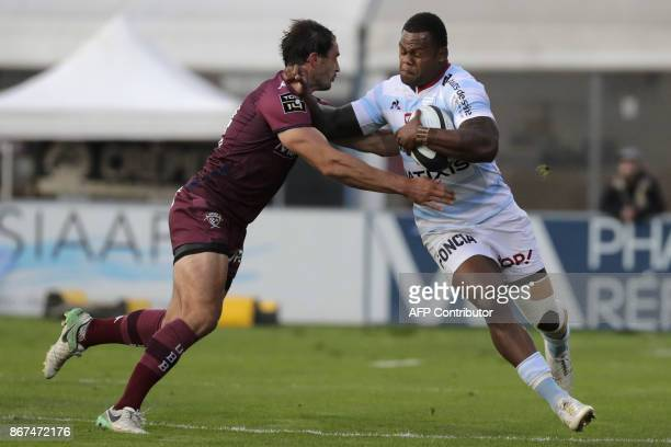 Racing-Metro's winger Virimi Vakatawa vies with Bordeaux-Begles' French winger Nans Ducuing during the French Top 14 rugby union match between Racing...