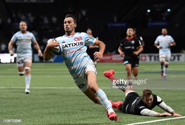 Racing's Argentinian left wing Juan Imhoff runs to score a try during the European Rugby Champions Cup semi-final rugby union match between Racing 92...