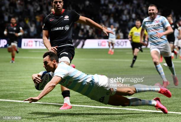 Racing's Argentinian left wing Juan Imhoff scores a try during the European Rugby Champions Cup semi-final rugby union match between Racing 92 and...
