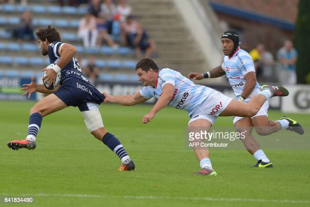 Racing's French centre Henri Chavancy tackles Agen's centre Julien Heriteau during the French Top 14 rugby union match between Agen and Racing 92 on...