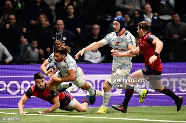 Racing's French hooker Dimitri Szarzewski scores a try during the European Champions Cup rugby union match between Racing 92 and Munster on January...