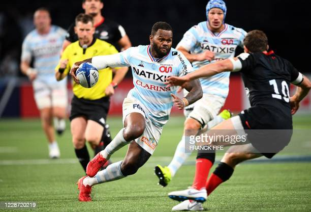 Racing's French outside centre Virimi Vakatawa runs the ball during the European Rugby Champions Cup semi-final rugby union match between Racing 92...