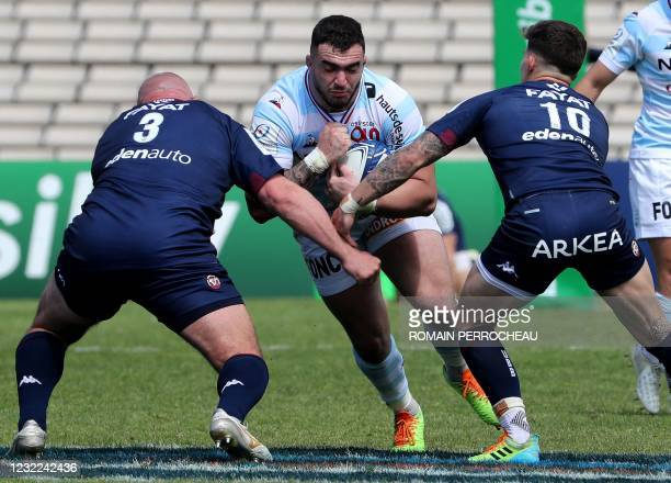 Racing's French prop Teddy Baubigny is challenged during the european Champions Cup rugby union quarter final match between Bordeaux-Begles and...