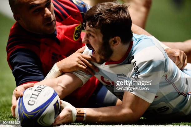 Racings French winger Marc Andreu scores a try during the European Champions Cup rugby union match between Racing 92 and Munster on January 14 2018...