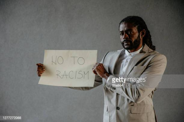 racism is not welcomed here - supreme court justice stock pictures, royalty-free photos & images