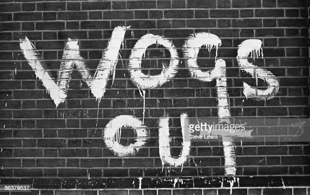 Racist graffiti in the East End of London 1960s The words 'Wogs Out' are scrawled on a brick wall