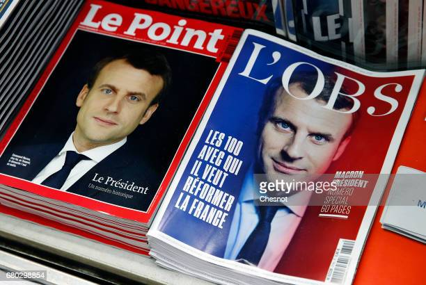 A rack displays French magazine front covers for Le Point and L'Obs with the picture of the newly elected French president Emmanuel Macron a day...